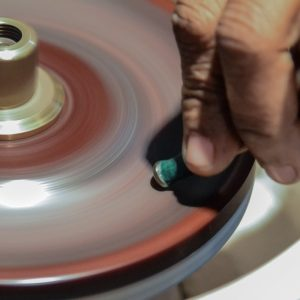 The cutting and polishing process involved constant spinning of the cabochon on the lapidary wheel.